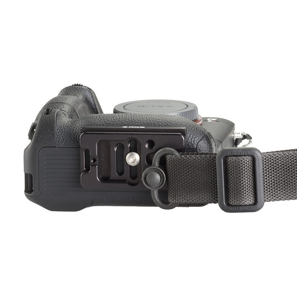Plate for Sony Alpha a7RIII seen on camera bottom view with QD strap attached