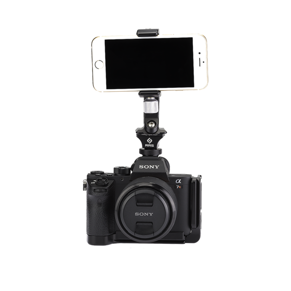 Camera with hot shoe adapter, SNAP QR Adapter and phone clamp attached. Phone clamp is holding an iPhone.