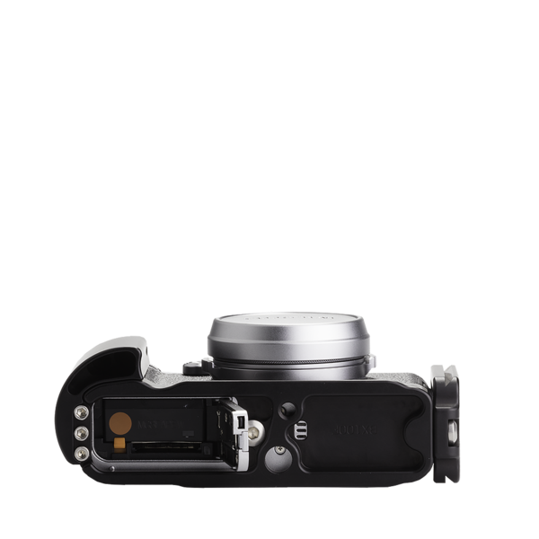 Base plate, L-component and battery grip on Fujifilm X100F - bottom view. The battery can be easily accessed without removing the base plate.
