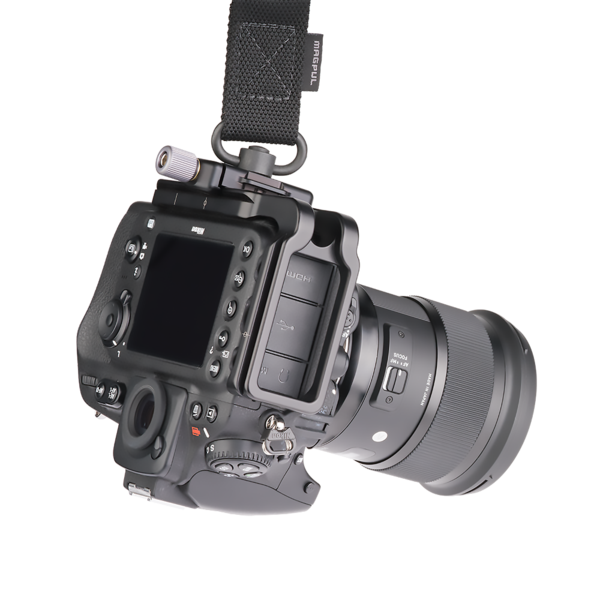 Quick release clamp: B2-FABN-Micro mounted with QD strap on DSLR camera.