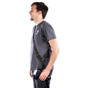 Bi-directional plate attached to camera and sling on a photographer