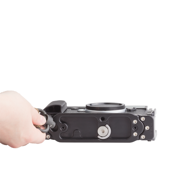 The base plate for Leica M10 has a QD socket where straps can be mounted.